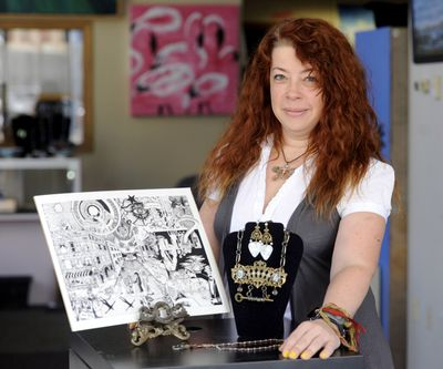 Megan Holden, shown at the Cat's Eye Gallery on Aug. 19, makes pen-and-ink drawings and assembles jewelry, which she sells at fairs and markets. (Jesse Tinsley)