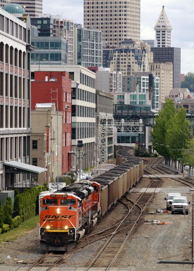 A coal train leaves Seattle for British Columbia in May 2012. (Elaine Thompson / Associated Press)