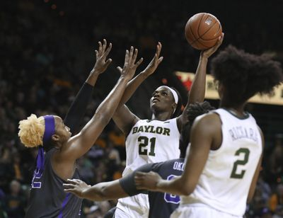 Baylor center Kalani Brown, right, scores over TCU center Jordan Moore, left, during Saturday's game. Baylor won 89-71. (Rod Aydelotte / Associated Press)