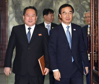 South Korean Unification Minister Cho Myoung-gyon, right, and his North Korean counterpart Ri Son Gwon arrive to hold their meeting at the northern side of Panmunjom in the Demilitarized Zone, North Korea, Monday, Aug. 13, 2018. (Associated Press)