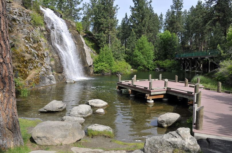 The pond and landscaped area known as Mirabeau Springs in Mirabeau Point Park was once the tiger enclosure at Walk in the Wild Zoo, which closed in the 1990s. The area was reclaimed as the park, which sits behind the YMCA and CenterPlace in Spokane Valley. (Jesse Tinsley)