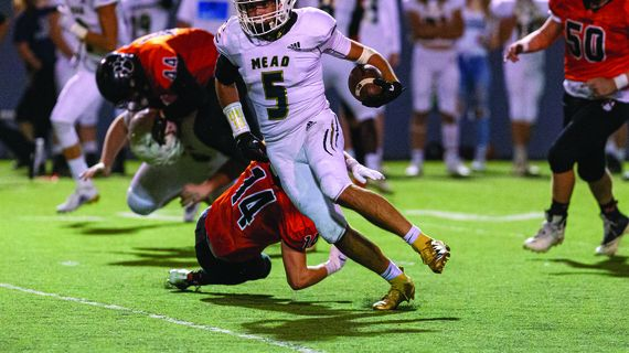 Mead running back Caleb Shawen (5) breaks a tackle against Lewis and Clark on Thursday, Sept. 19, 2019, at Joe Albi Stadium in Spokane, Wash. (Cheryl Nichols/For The Spokesman-Review)