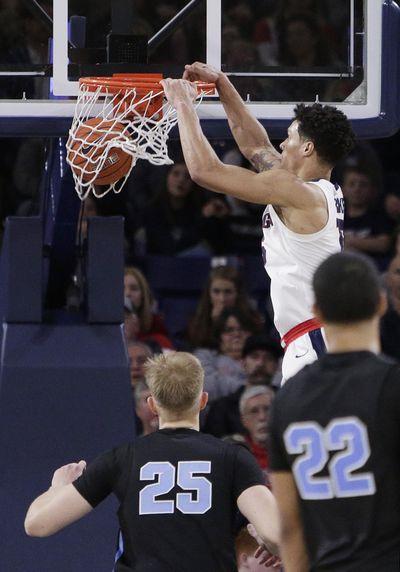 Gonzaga forward Brandon Clarke dunks during the second half against San Diego. (Young Kwak / Associated Press)