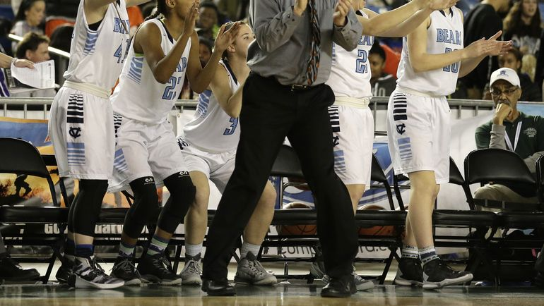 Central Valley head coach Freddie Rehkow cheers with his players on the bench late in the second half of the Washington state girls 4A high school basketball championship against Snohomish, Saturday, March 5, 2016, in Tacoma, Wash. Central Valley beat Snohomish 57-48.  (AP/Ted S. Warren)