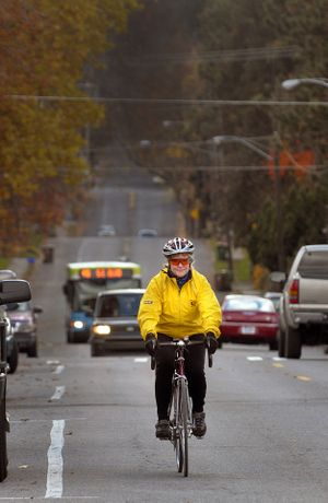 Eileen Hyatt rides north on Perry Street from the South Hill neighborhood last November. She is an advocate for safety and helping make Spokane more  bicycle friendly.  (Christopher Anderson)