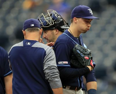 """Tampa Bay Rays starting pitcher Blake Snell, right, is taken out by manager Kevin Cash, left, during the fourth inning of a May 1, 2019 game against the Kansas City Royals at Kauffman Stadium in Kansas City, Mo. Rays All-Star pitcher Blake Snell says he will not take the mound this year if his pay is cut further, proclaiming: """"I'm not playing unless I get mine."""" the 2018 AL Cy Young Award winner said on a Twitch stream Wednesday, May 14 2020. (Orlin Wagner / AP)"""