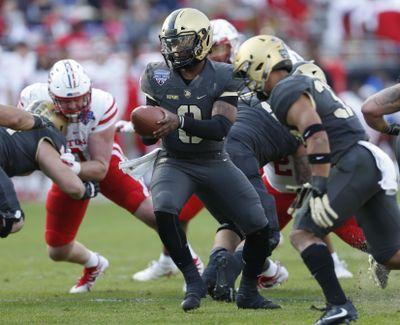 Army quarterback Kelvin Hopkins Jr.  prepares to hand off the ball against Houston during the first half of the Armed Forces Bowl  on Saturday  in Fort Worth, Texas. (Jim Cowsert / AP)