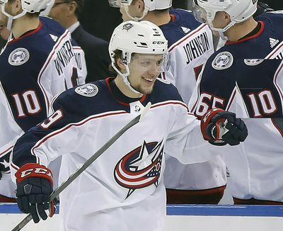 In this March 20, 2018, file photo, Columbus Blue Jackets left wing Artemi Panarin is congratulated by teammates after scoring a goal against the New York Rangers. On Thursday, Panarin, now with the New York Rangers, decried the lack of freedom of expression in his home country and put the blame on Russian President Vladimir Putin. (Julie Jacobson / AP)