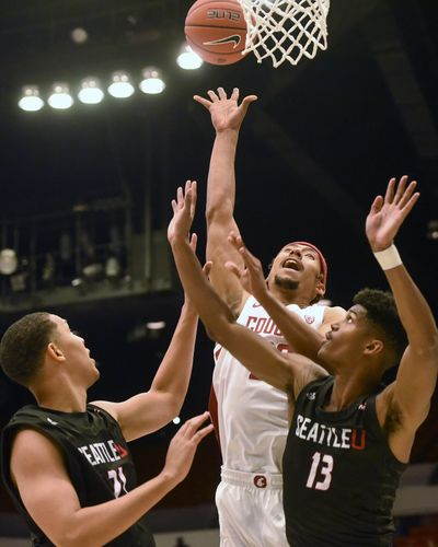 Washington State forward Deion James (20) attempts a shot as Seattle center Jordan Dallas (21) and guard Morgan Means (13) defend during the first half of an NCAA college basketball game Thursday, Nov. 7, 2019, in Pullman, Wash. (Pete Caster / AP)