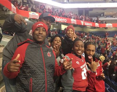 Members of Renard Bell's family pose for a photo before Washington State's appearance in the 2018 Alamo Bowl. Bell, a Los Angeles native and senior wide receiver for the Cougars, will be traveling home for Sunday's game at USC but won't have an opportunity to see family and friends.  (Reginald Bell/Courtesy)