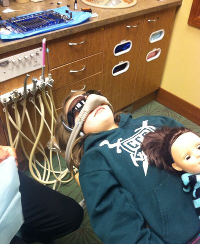 "Sedation has eased dental procedures for Danyel Swenson, wearing an ""elephant nose"" delivering nitrous oxide and accompanied by her doll Grace at KiDDS Dental in Liberty Lake. The Spokane Valley girl, now 8, has had teeth pulled and cavities filled despite anxiety, her mother said – and wants to be a dentist when she grows up."