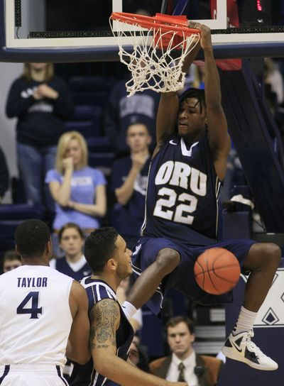 Oral Roberts forward Steven Roundtree (22) dunks the basketball as Xavier's Travis Taylor (4) watches. (Associated Press)
