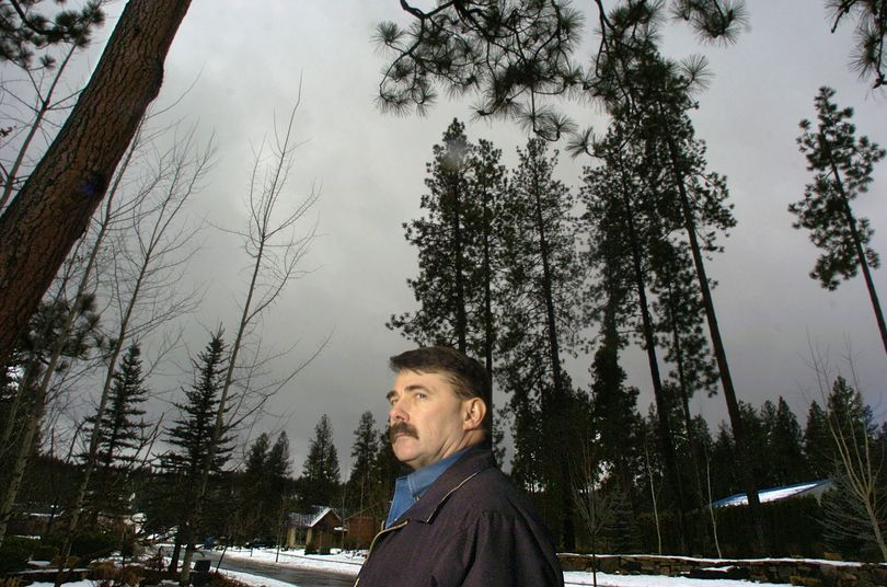 Kootenai County sheriff's Sgt. Brad Maskell stands in the area where newspaper carrier Gary Loesch was murdered in November 1995. Two years later, his widow, Barbara, was found slain at her Post Falls home. (Christopher Anderson / The Spokesman-Review)