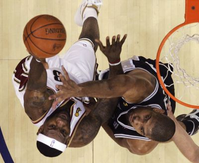 Cavaliers' LeBron James, left, and Spurs' Tim Duncan are back in NBA Finals. (Associated Press)