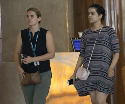 Rahaf Mohammed Alqunun, right, walks with an unidentified companion in Bangkok, Thailand, on Friday, Jan. 11, 2019. Alqunun, the 18-year old Saudi woman who fled her family to seek asylum, remains in Thailand under the care of the U.N. refugee agency as she awaits a decision by a third country to accept her as a refugee. (Sakchai Lalit / AP)