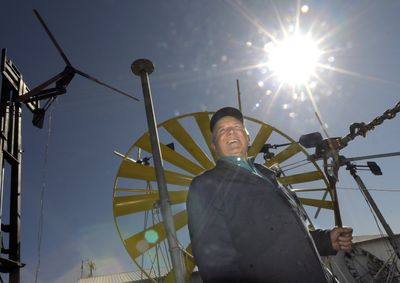 Eduard Ribic is framed in the blades of a windmill at his shop near Airway Heights on April 6. Ribic has been involved in developing, building and selling wind and solar power for almost 30 years.  (CHRISTOPHER ANDERSON / The Spokesman-Review)