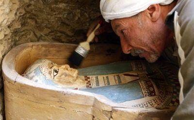 An Egyptian worker brushes the  sarcophagus of an Illahun mayor's daughter (circa 931-725 B.C.)  inside a rock-cut tomb.  (Associated Press / The Spokesman-Review)