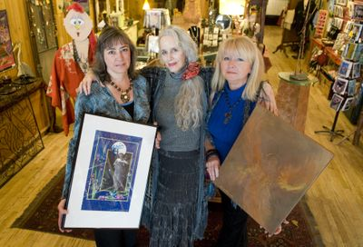 Artist's Tree Gallery owner Michele  Mokre, center, will be showing works from Ellen Blaschke, right, who does abstract angels in acrylic and Sandy Roistacher, left, who does realistic angel prints and ceramic sculptures she calls touchstones. (Colin Mulvany / The Spokesman-Review)