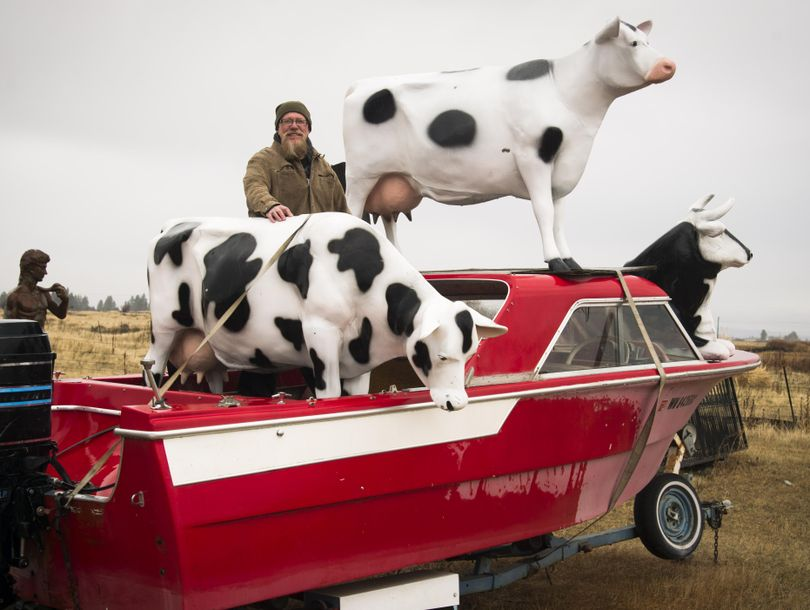 These cows on a motor boat turn heads for drivers heading west on I-90. Way Out West, owned by Mike Ferguson, sells a huge variety of traditional and funky-style statuary. (Colin Mulvany / The Spokesman-Review)