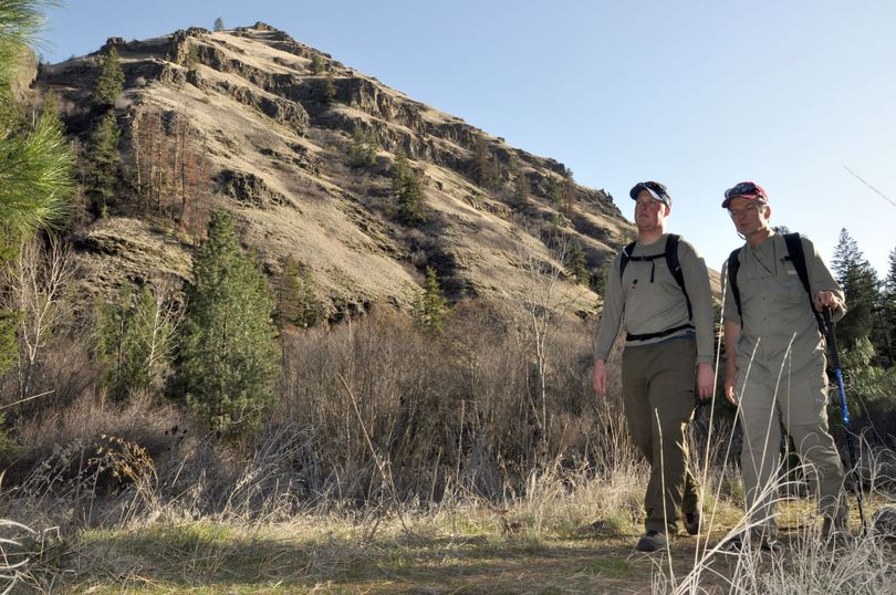 Myles Heistad, left, and Scott Wolff hike the trail along the North Fork of Asotin Creek before buds have opened on trees and plants in the foothills of the Blue Mountains of southeastern Washington. (Rich Landers)