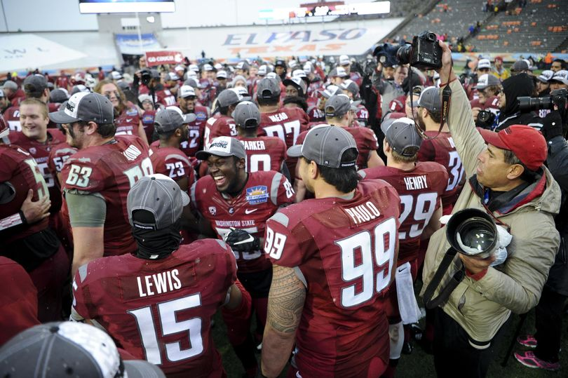 Washington State celebrates after defeating Miami during the second half of the 2015 Hyundai Sun Bowl on Saturday, Dec 26, 2015, at Sun Bowl Stadium in El Paso, TX. (Tyler Tjomsland / The Spokesman-Review)