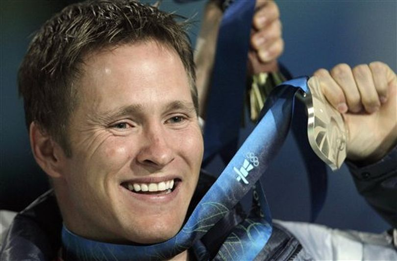In this Feb. 26, 2010 file photo, Jeret Peterson, of the United States, holds his silver medal during the medals ceremony for the men's freestyle skiing aerials at the Vancouver 2010 Olympics in Vancouver, British Columbia. Utah police say Peterson has killed himself in an isolated canyon. The Unified Police of Greater Salt Lake said Peterson called 911 before shooting and killing himself on Monday evening, July 25, 2011. (AP Photo / Gerry Broome)