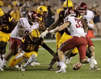 Arizona State quarterback Dillon Sterling-Cole (15) fumbles the football as Washington State defensive lineman Dylan Hanser (33) and nose tackle Robert Barber (92) defend during the second half of an NCAA college football game, Saturday, Oct. 22, 2016, in Tempe, Ariz. (Matt York / AP)