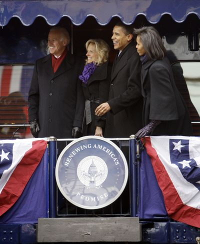 On to D.C.: Vice President-elect Joe Biden, left, his wife, Jill, President-elect Barack Obama and his wife, Michelle, pose for photographs in Wilmington, Del., Saturday on their whistle-stop  train trip to Washington.  (Associated Press / The Spokesman-Review)