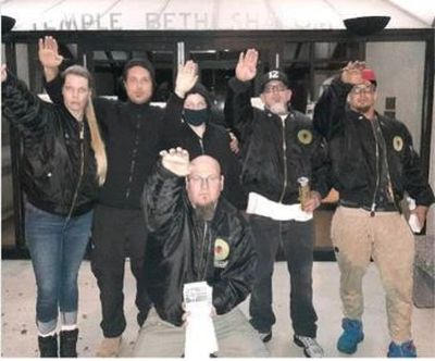 Raymond Bryant, 44, kneeling, threw a Nazi