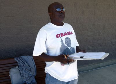 A man  stands outside Target on Sprague Avenue in Spokane Valley  May 21 collecting signatures for a petition to disincorporate the city.  (J. BART RAYNIAK / The Spokesman-Review)