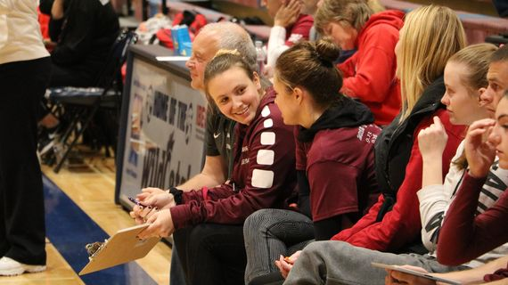 New Mt. Spokane volleyball coach Laurie Quiqley, facing, smiles during a match last season. (Courtesy / Jason Davis)
