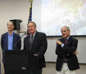 Sen. Mike Crapo, center, speaks at the Boise Interagency Fire Center on Monday; at left is Oregon Sen. Ron Wyden, at right, Idaho Sen. Jim Risch (Betsy Z. Russell)