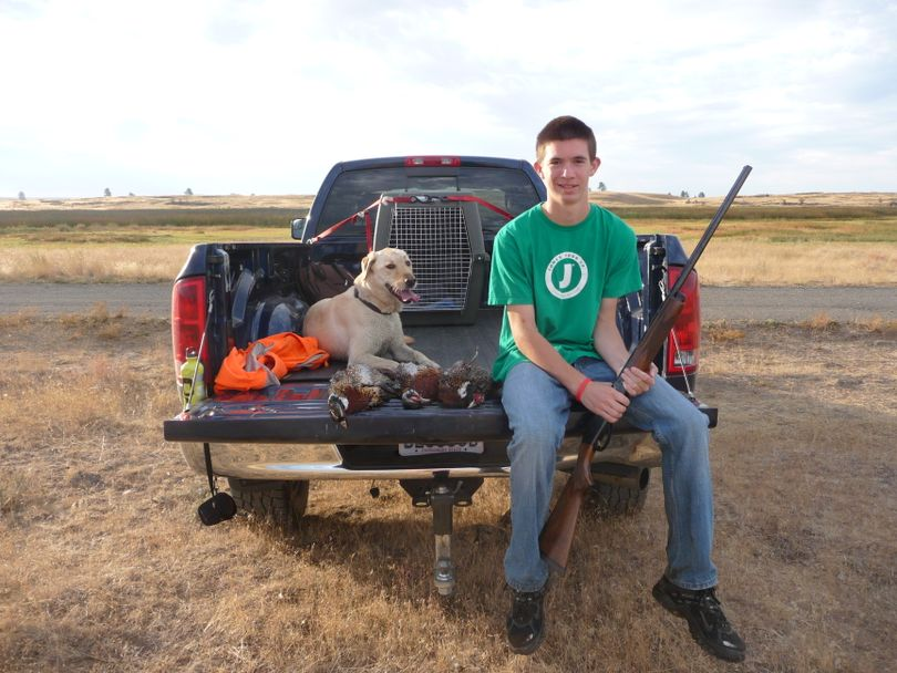 Daniel Kuhta had a limit of fun with his dog and his father, Scott Kuhta, during the Youth Upland Game Bird hunting season in the last weekend in September. (Scott Kuhta)