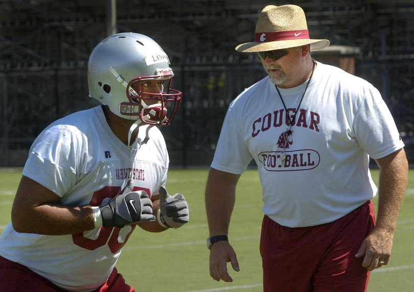 One of George Yarno's coaching jobs was at his alma mater, Washington State. In this 2007 photo, he is shown coaching offensive linemen. (Dan Pelle / The Spokesman-Review)