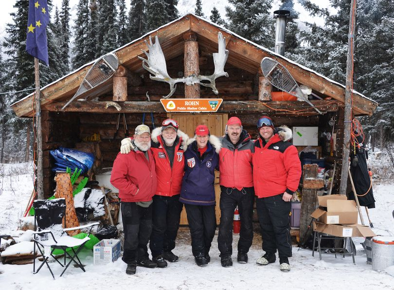 The crew at Rohn Checkpoint on the Iditarod Trail pose with two Washington snowmobilers. Josh Rindal of Spokane and Bob Jones of Kettle Falls were snowmobiling 1,400-miles along the route of Alaska's famous Iditarod Sled Dog Race in March 2014. (Robert Jones)