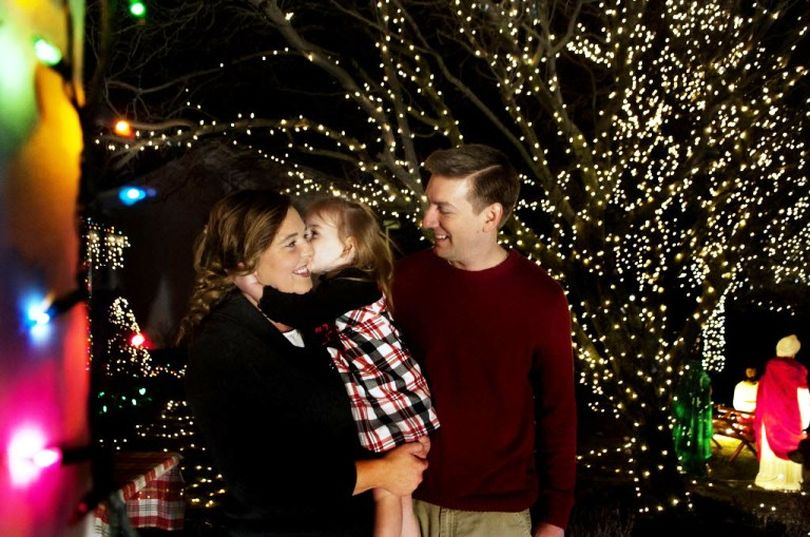 This Dec. 18, 2014, SR file photo shows Jeremy Morris next to his wife Kristy and their daughter Savannah Claire, then 3, in front of their home in Hayden. The couple had transformed their home into a holiday destination with an abundance of lights, music, a choir, and a live camel and free hot chocolate. (Kathy Plonka/SR file photo)