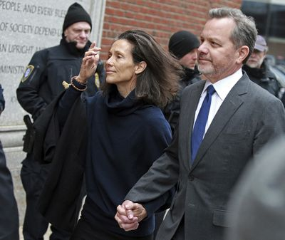 FILE - In this Friday, March 29, 2019, file photo, William McGlashan, right, of Mill Valley, Calif., arrives at the federal courthouse in Boston for a hearing in a nationwide college admissions bribery scandal. McGlashan, a former private equity executive who cofounded an investment fund with U2′s Bono was sentenced Wednesday, May 12, 2021, to three months in prison for his role in the college admissions bribery scheme. The former TPG Capital senior executive, admitted in February to paying $50,000 to have someone secretly correct his son's ACT answers.  (Matt Stone)