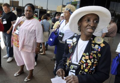 Delores Harris, right, of Memphis, Tenn., waits  at the Spokane Convention Center for a tour bus to take Neighborhoods, USA participants around the area Friday.   (Dan Pelle / The Spokesman-Review)