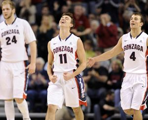 Gonzaga's David Stockton, center, and Kevin Pangos, right, celebrate a scoring run as they head to a timeout in the second half Saturday, Dec. 28, 2013 at the McCarthey Athletic Center. The Zags beat the Santa Clara Broncos 74-60. (Jesse Tinsley / The Spokesman-Review)