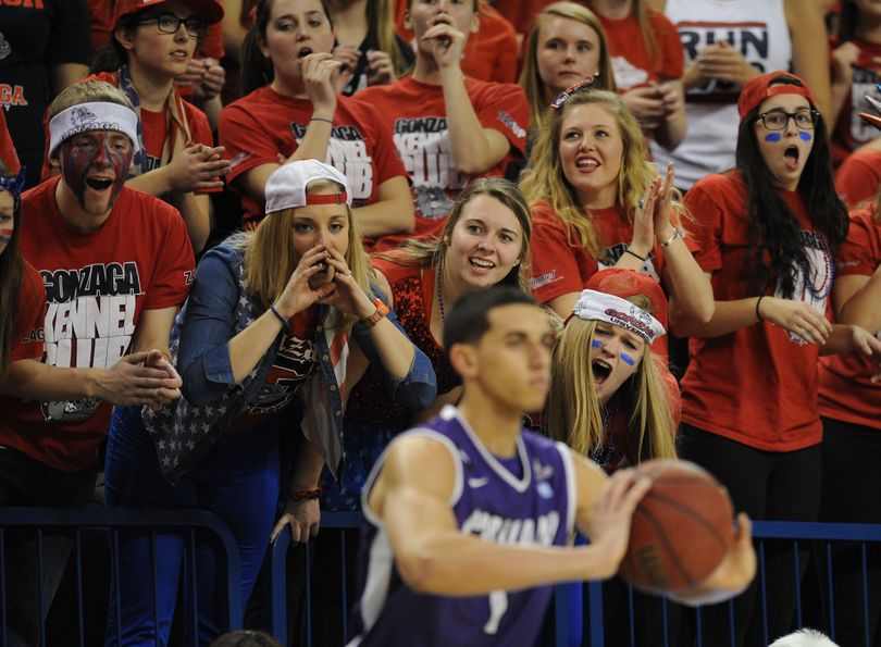 Gonzaga's student section unleashes a barrage of commotion as Portland's Bryce Pressley tries to inbound the ball Feb. 5 in Spokane. (Colin Mulvany)