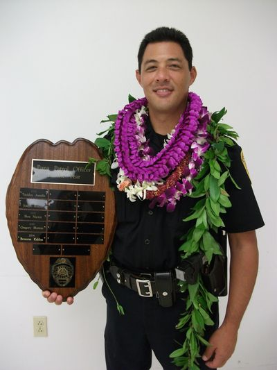 This undated file photo provided by the Hawaii County Police Department shows Officer Bronson Kaliloa. Hawaii's entire Big Island police force was on alert Wednesday, July 18, 2018, for Justin Joshua Waiki, a suspect wanted in the killing of Kaliloa during a traffic stop, including off-duty officers and some who returned to work from vacation and days off to join in the search. (AP)