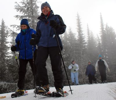 Carol Gauper and Annette Sanburn join a guided snowshoeing trek at last winter's Souper Bowl.  (File / The Spokesman-Review)