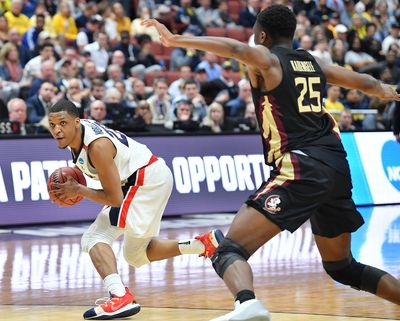 In this March 28, 2019 photo, Gonzaga guard Zach Norvell Jr. looks for an opening against Florida State forward Mfiondu Kabengele during a 2019 NCAA basketball tournament game at the Honda Center in Anaheim, Calif. (Tyler Tjomsland / The Spokesman-Review)