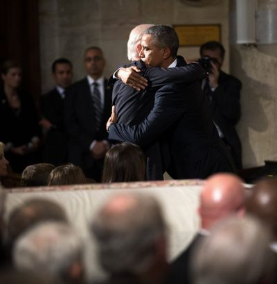 President Obama hugs Vice President Joe Biden during the funeral services for Biden's son, Beau Biden, Saturday, June 6, 2015, at the St. Anthony of Padua Church in Wilmington, Del. (Doug Mills / The New York Times Times)