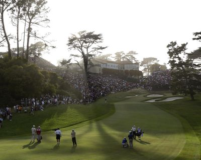 Tiger Woods and Jim Furyk make their way to the 18th green during the third round of the U.S. Open Championship golf tournament Saturday, June 16, 2012, at The Olympic Club in San Francisco. (AP Photo/Eric Gay) (Eric Gay / AP)