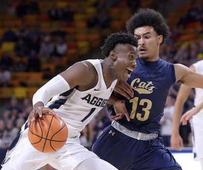 Montana State guard Isaac Bonton (13) defends Utah State's Koby McEwen (1) during an NCAA basketball game, Monday, Nov. 13, 2017, in Logan, Utah. (Eli Lucero / AP)