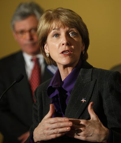 Martha Coakley talks with reporters Thursday during a campaign stop  in New Bedford, Mass. (Associated Press)