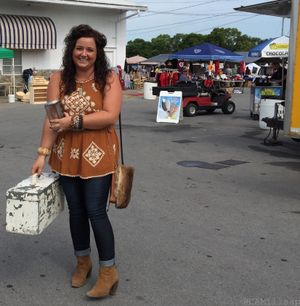 A shopper shows off the vintage tool box she purchased at the Nashville Flea Market. (Photo by Cheryl-Anne Millsap)