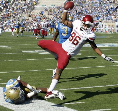 Washington State wide receiver Marquess Wilson, right, gets knocked out of bounds by UCLA safety Tony Dye in the fourth quarter. Replays appeared to show the Wilson crossed the goal line before his right foot came down out-of-bounds. (Chris Carlson / Associated Press)