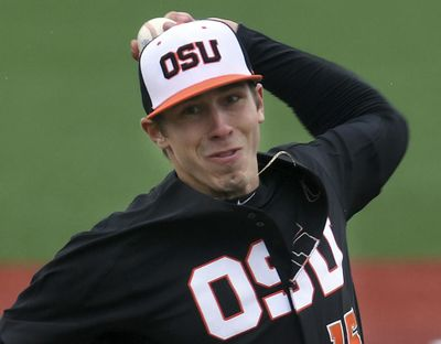 FILE - In this March 4, 2017, file photo, Oregon State pitcher Luke Heimlich throws during an NCAA college baseball gameMarch 4, 2017, against UC Davis in Corvallis, Ore. Heimlich, who as a teenager pleaded guilty to molesting a 6-year-old girl, will not accompany the Beavers to the College World Series. The 21-year-old left-hander made the announcement in a statement released through a representative for his family. He called going to the series something that he and his teammates have worked toward all year. (Mark Ylen / AP)
